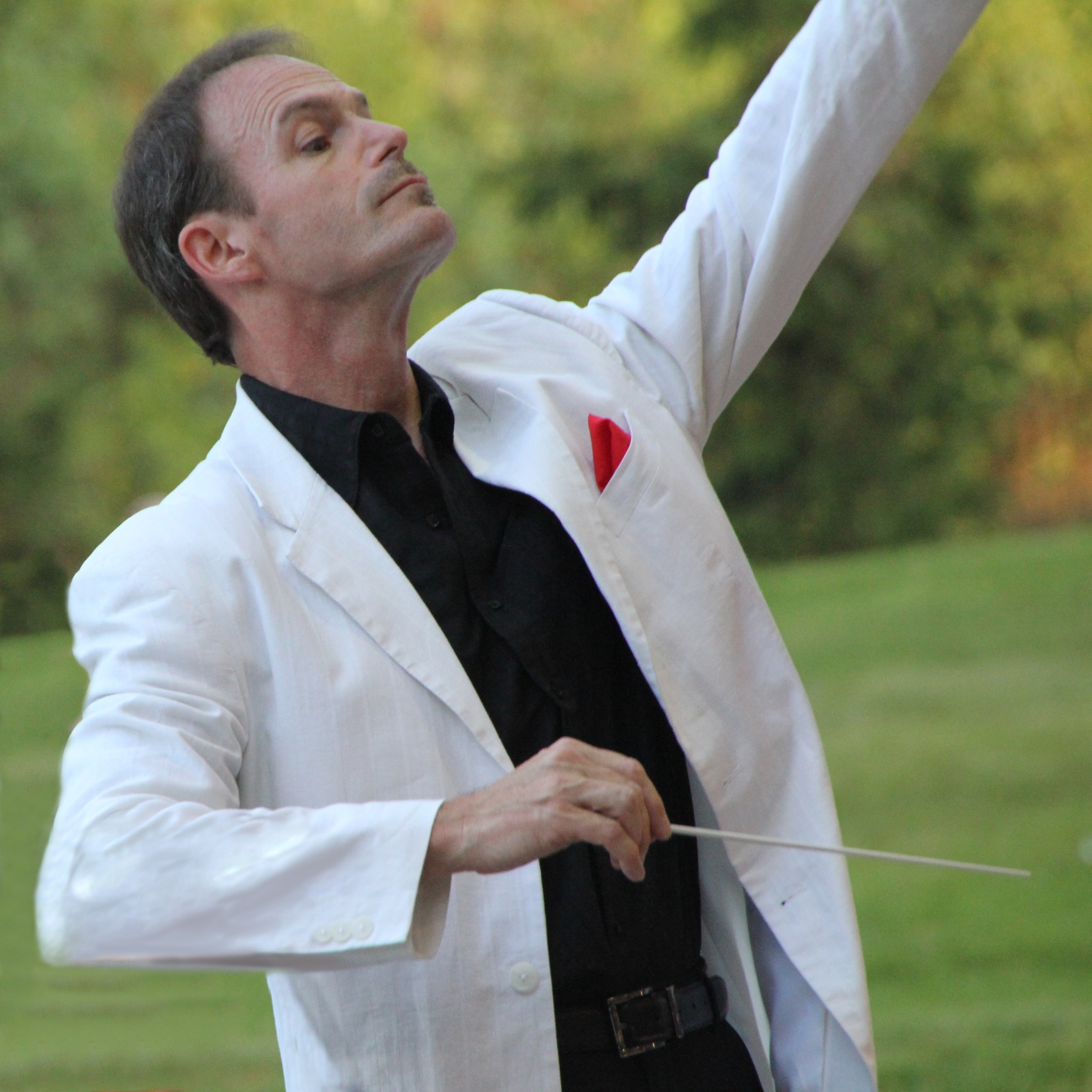 Philip Bauman conducts a summer pops concert